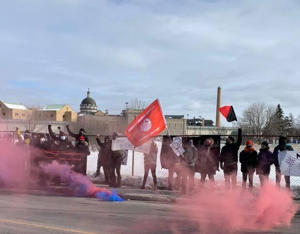 A union representing intervention workers protested outside Bordeaux prison Saturday, calling on the government to prioritize inmates in its COVID-19 vaccine rollout plans.  (Josh Grant/CBC - image credit)
