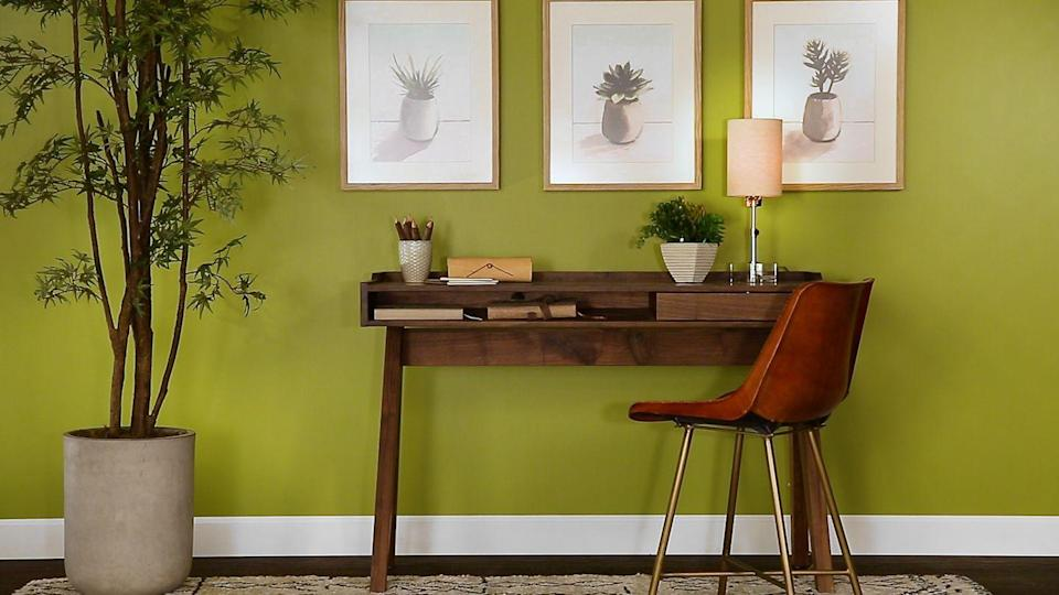 "<p><strong>Paint color: </strong>Crushed Oregano by Valspar</p><p>We feel energized just looking at this wall! ""This balanced yellow green captures the essence of spring's first blooms and the excitement for the season ahead,"" Kim notes. ""Green also brings positive energy into a space and stimulates personal growth.""</p>"