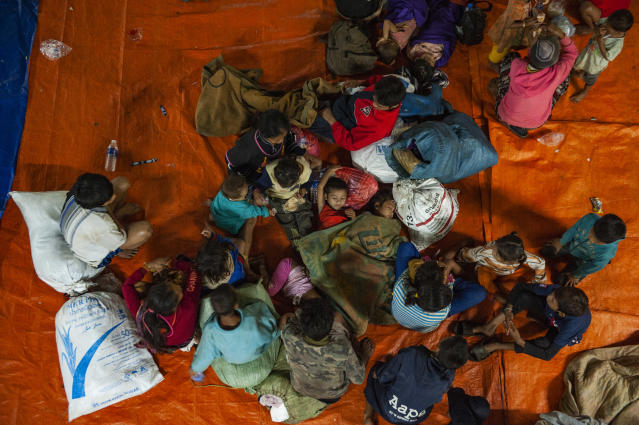 <p>Villagers from Sanam Say district take refuge in a makeshift evacuation center after they escaped the fast rising waters from the damaged dam on July 25, 2018 in Champasak, southern Laos. (Photo: Jes Aznar/Getty Images) </p>