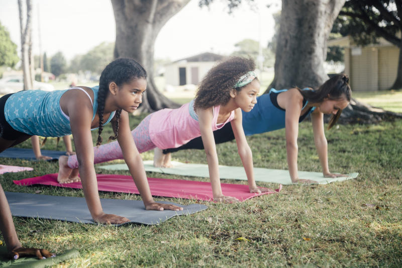 Little girls practicing the plank.