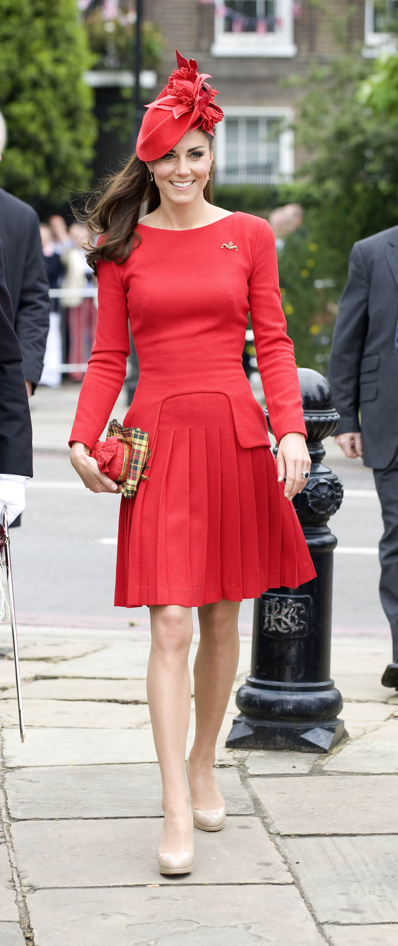 <p>Kate enlisted the house of Alexander McQueen to design a bespoke red dress for the Queen's Diamond Jubilee. She carried a matching McQueen bow clutch and wore a hat by Lock & Co. </p><p><i>[Photo: PA]</i></p>