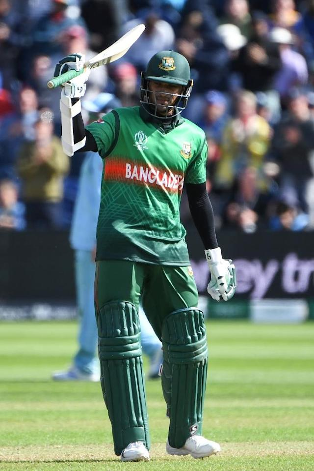 Bangladesh's Shakib Al Hasan celebrates after reaching his century in the World Cup match against England (AFP Photo/Paul ELLIS)
