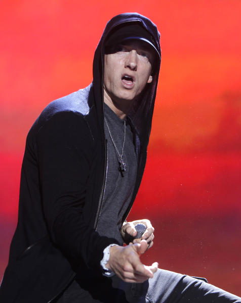 File-This Sept. 10, 2010 file photo shows rapper Eminem performing at Yankee Stadium in New York. The first YouTube Music Awards had all kinds of unexpected moments, imagined by Spike Jonze and carried off by the odd-couple hosts Jason Schwartzman and Reggie Watts. Eminem won artist of the year, and Taylor Swift and Macklemore & Ryan Lewis were among the winners during Sunday night's live webcast from New York. But the awards were sort of beside the point as Jonze and others directed live videos with Eminem, Lady Gaga, M.I.A. and Earl Sweatshirt, and Schwartzman and Watts careened about the soundstage with no script and only notecards to point the way. (AP Photo/Jason DeCrow, File)