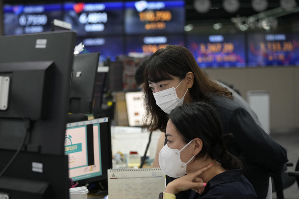 Currency traders watch monitors at the foreign exchange dealing room of the KEB Hana Bank headquarters in Seoul, South Korea, Wednesday, June 23, 2021. Asian stock markets followed Wall Street higher on Wednesday after the Federal Reserve chairman said higher U.S. inflation probably is temporary, helping to calm fears central bankers might feel pressure to roll back economic stimulus. (AP Photo/Ahn Young-joon)