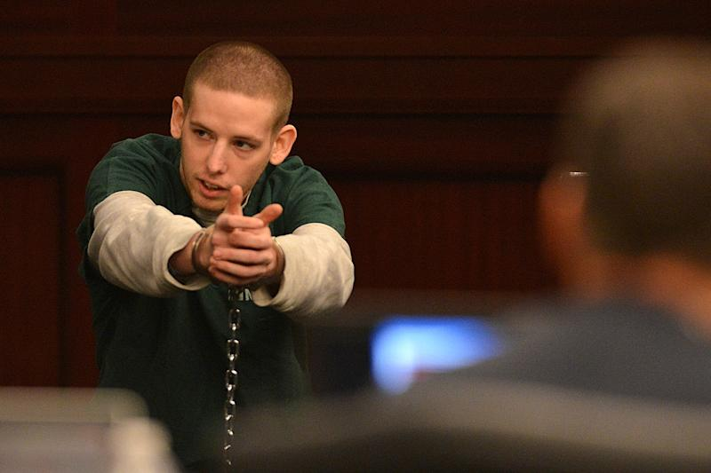 Shawn Atkins, currently in prison on theft charges, testifies in the trial of Michael Dunn in Jacksonville, Fla., Thursday, Feb. 6, 2014. Atkins provided an eye witness account and the license tag of Dunn's car to police. Dunn is accused in the shooting death of Jordan Davis, who was outside a store with friends in November 2012. (AP Photo/Bob Mack, Pool)