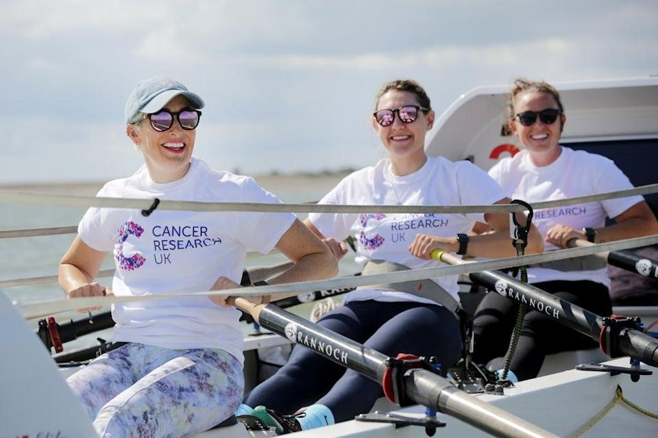 From left, Kat Cordiner, Charlotte Irving and Abby Johnston preparing to take part in the the Talisker Whisky Atlantic Challenge (Cancer Research UK/PA) (PA Media)