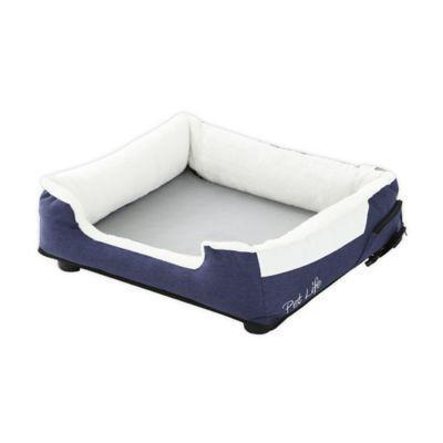 """<p><strong>Pet Life</strong></p><p>bedbathandbeyond.com</p><p><strong>$99.99</strong></p><p><a href=""""https://go.redirectingat.com?id=74968X1596630&url=https%3A%2F%2Fwww.bedbathandbeyond.com%2Fstore%2Fproduct%2Fpet-life-dream-smart-heating-and-cooling-pet-bed%2F5485692&sref=https%3A%2F%2Fwww.countryliving.com%2Flife%2Fkids-pets%2Fg34383097%2Fbest-heated-dog-beds%2F"""" rel=""""nofollow noopener"""" target=""""_blank"""" data-ylk=""""slk:Shop Now"""" class=""""link rapid-noclick-resp"""">Shop Now</a></p><p>Sure, it's cold NOW, but Summer is always around the corner. Warm your dog up or cool him down with the press of a button. </p>"""