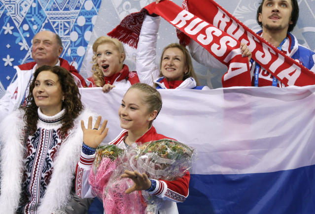 Yulia Lipnitskaya of Russia, centre, waits for her results after competing in the women's team short program figure skating competition at the Iceberg Skating Palace during the 2014 Winter Olympics, Saturday, Feb. 8, 2014, in Sochi, Russia. (AP Photo/Darron Cummings, Pool)
