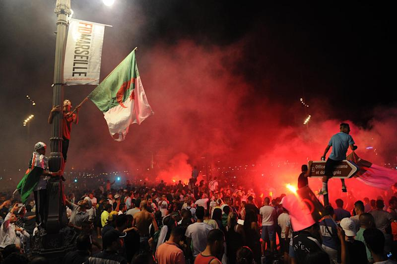 Algeria's football fans celebrate on the Canebiere in Marseille, southern France, on June 26, 2014 after the match Algeria vs Russia in a FIFA 2014 World Cup Group H match