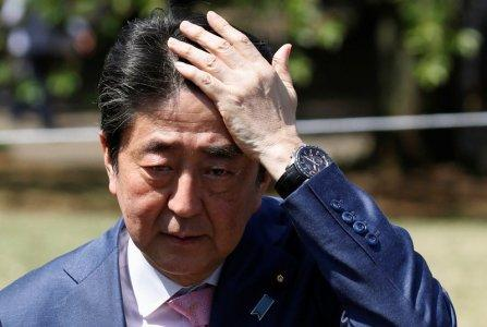 Japan's Prime Minister Shinzo Abe speaks to reporters after he attends a cherry blossom viewing party at Shinjuku Gyoen park in Tokyo, Japan, April 21, 2018. REUTERS/Toru Hanai