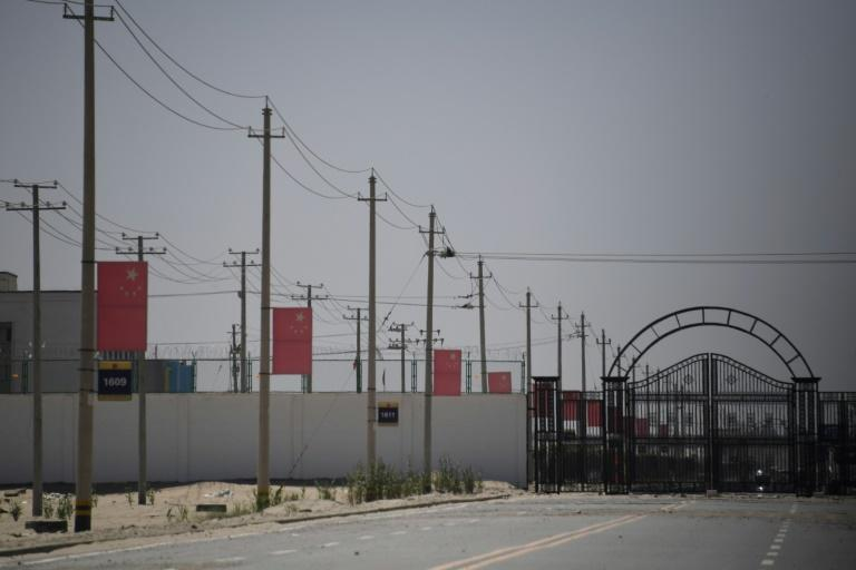 Chinese flags line a road in 2019 leading to a facility believed to be a re-education camp where mostly Muslim ethnic minorities are detained on the outskirts of Hotan in China's northwestern Xinjiang region