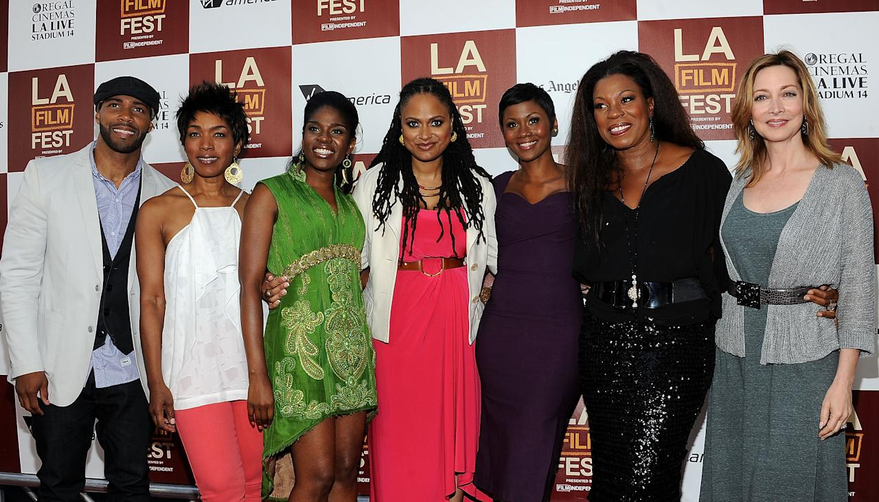 """LOS ANGELES, CA - JUNE 20:  (L-R) Actors Omari Hardwick, Angela Bassett, Edwina Findley, director Ava DuVernay, actors Emayatzy Corinealdi, Lorraine Toussaint and Sharon Lawrence arrive at Film Independent's 2012 Los Angeles Film Festival Premiere Of AFFRM & Participant Media's """"Middle Of Nowhere"""" at Regal Cinemas L.A. Live on June 20, 2012 in Los Angeles, California.  (Photo by Valerie Macon/Getty Images)"""