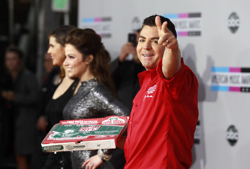 FILE PHOTO: John Schnatter, founder and CEO of Papa John's Pizza, arrives at the 2011 American Music Awards in Los Angeles