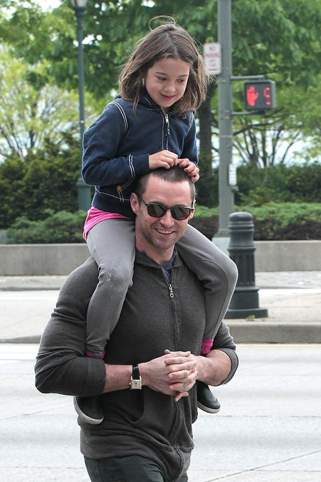 "Hugh Jackman shouldered the burden of transporting his 6-year-old, Ava, around New York City as their family visited High Line, an elevated park, as well as an art gallery. No wonder ""The Wolverine"" star always looks so toned in his movies!  (5/6/2012)"