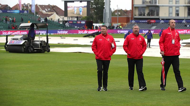 Umpires inspect the field during the bad weather. (Photo by Nick Potts/PA Images via Getty Images)