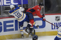 Buffalo Sabres defenseman Henri Jokiharju (10) and Washington Capitals right wing Richard Panik (14) collide during the first period of an NHL hockey game, Sunday, Jan. 24, 2021, in Washington. (AP Photo/Nick Wass)