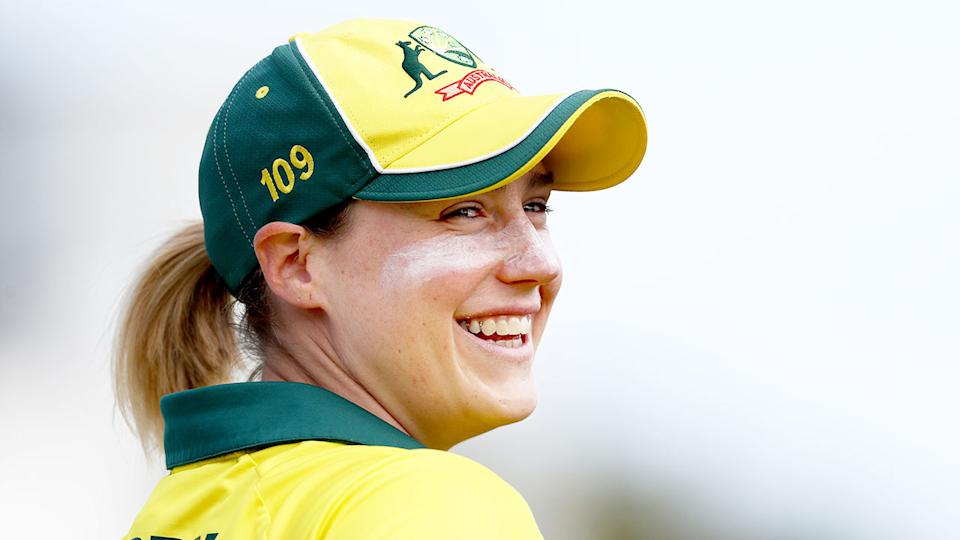 Pictured here, Australian women's cricket star Ellyse Perry smiles during an international match.