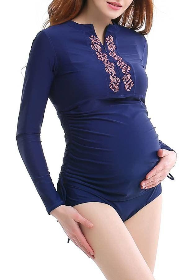 """Get it <a href=""""https://shop.nordstrom.com/s/kimi-and-kai-maternity-rashguard-swimsuit/4590951?origin=category-personalizedsort&fashioncolor=NAVY"""" target=""""_blank"""">here</a>."""