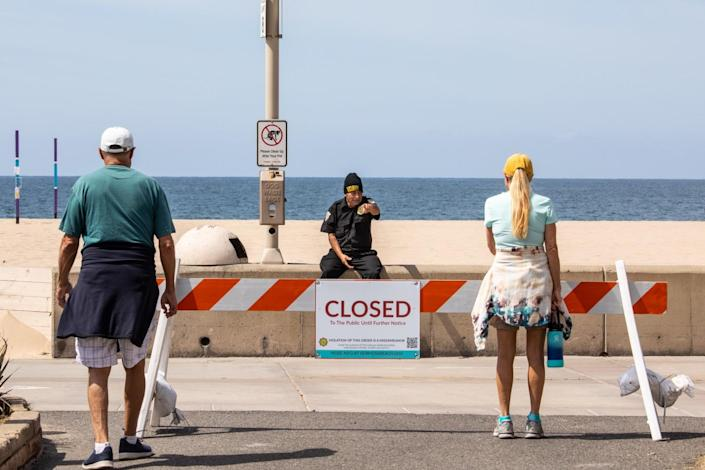 """The Hermosa Beach Police Department closed off the strand. <span class=""""copyright"""">(Jay L. Clendenin/ Los Angeles Times)</span>"""