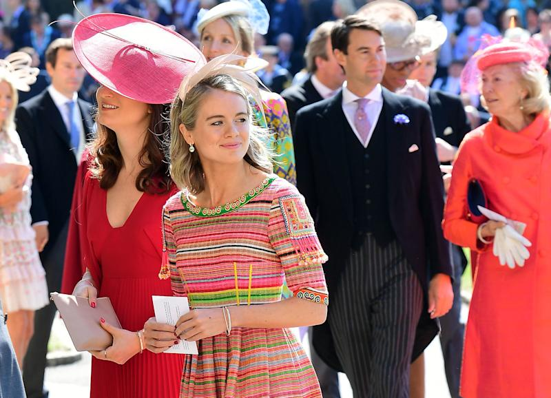 Cressida Bonas wears a bright striped dress with the small feathered fascinator. (IAN WEST via Getty Images)