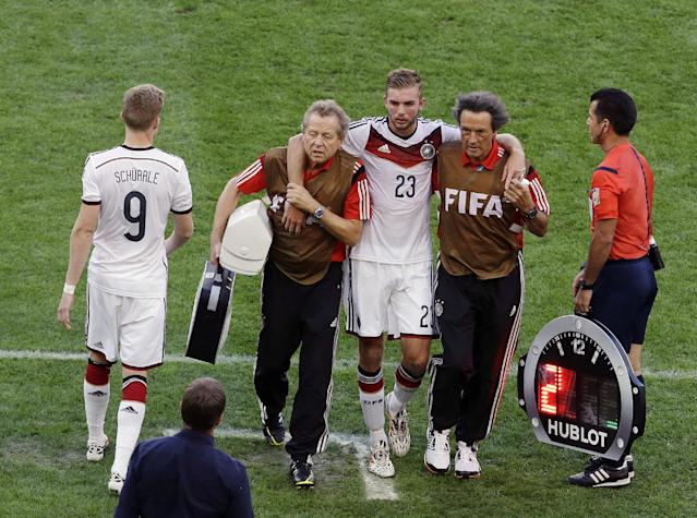 Germany's Christoph Kramer is substituted by Germany's Andre Schuerrle during the World Cup final soccer match between Germany and Argentina at the Maracana Stadium in Rio de Janeiro, Brazil, Sunday, July 13, 2014. (AP Photo/Hassan Ammar)