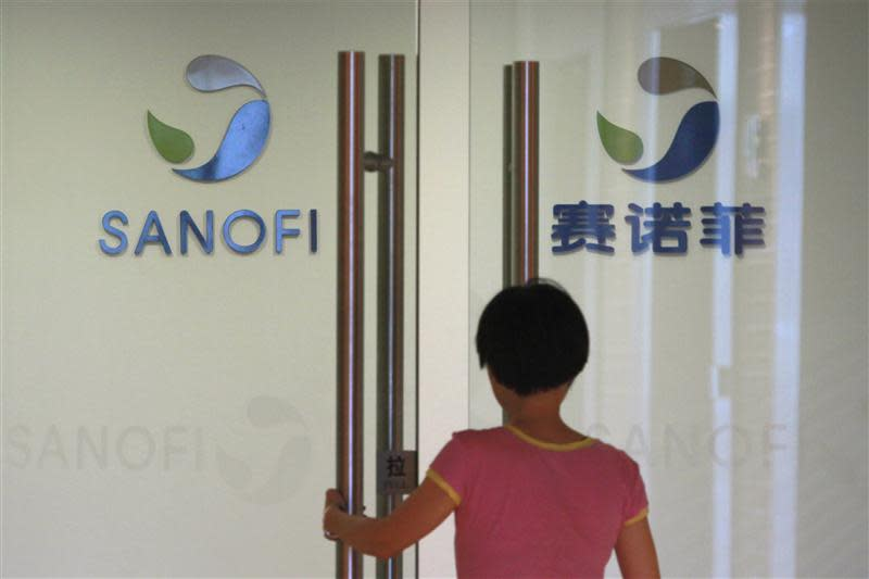 Employee walks into an office of French drugmaker Sanofi in Shanghai