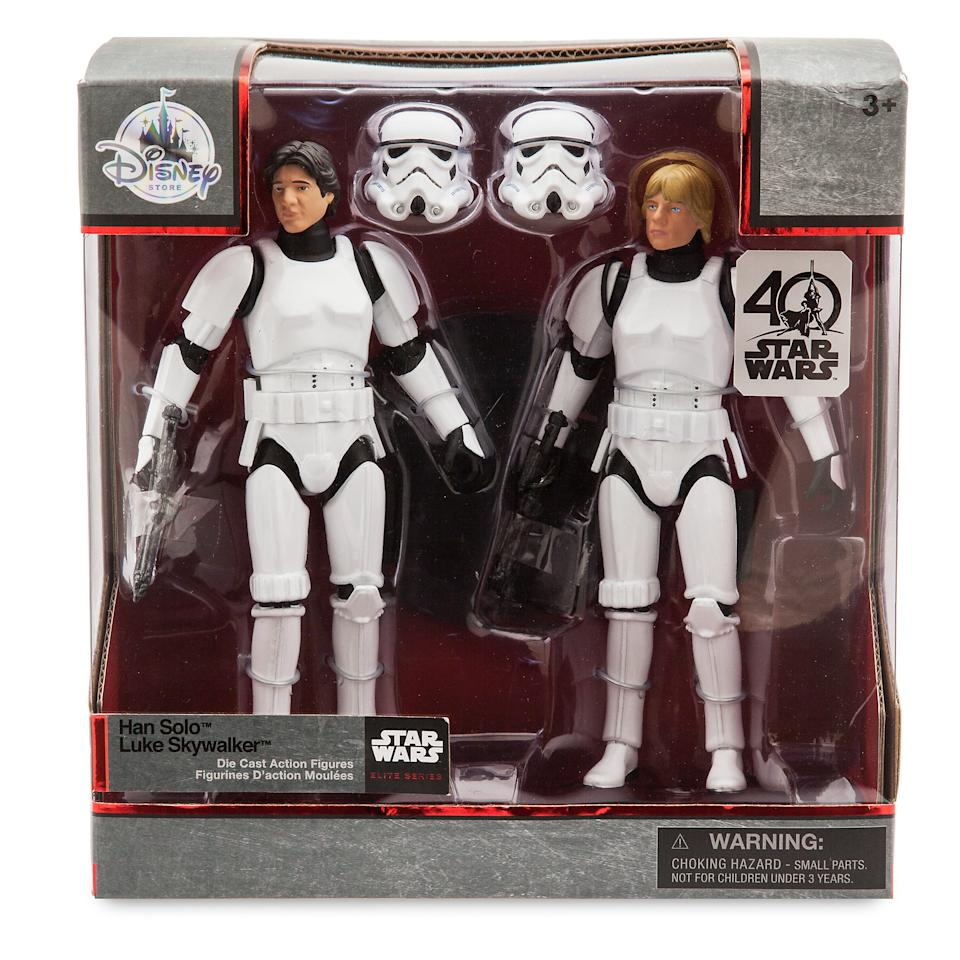 <p>Each $49.95 set includes both Han and Luke with detachable Stormtrooper helmets, two blasters, and two standing bases. (Credit: Disney Store) </p>