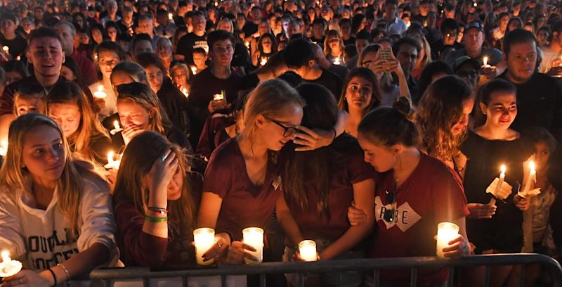 Mourners gather for a candlelight vigil for the victims of Wednesday's school shooting in Parkland, Florida. (Jim Rassol/Sun-Sentinel via Getty Images)