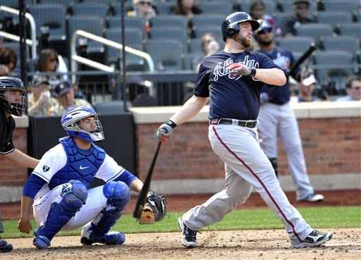 New York Mets catcher Josh Thole, second from left, watches Atlanta Brave's Brian McCann, right, hit a solo home run off Mets' Chris Young in the sixth inning of a baseball game on Sunday, Sept. 9, 2012, at Citi Field in New York. (AP Photo/Kathy Kmonicek)