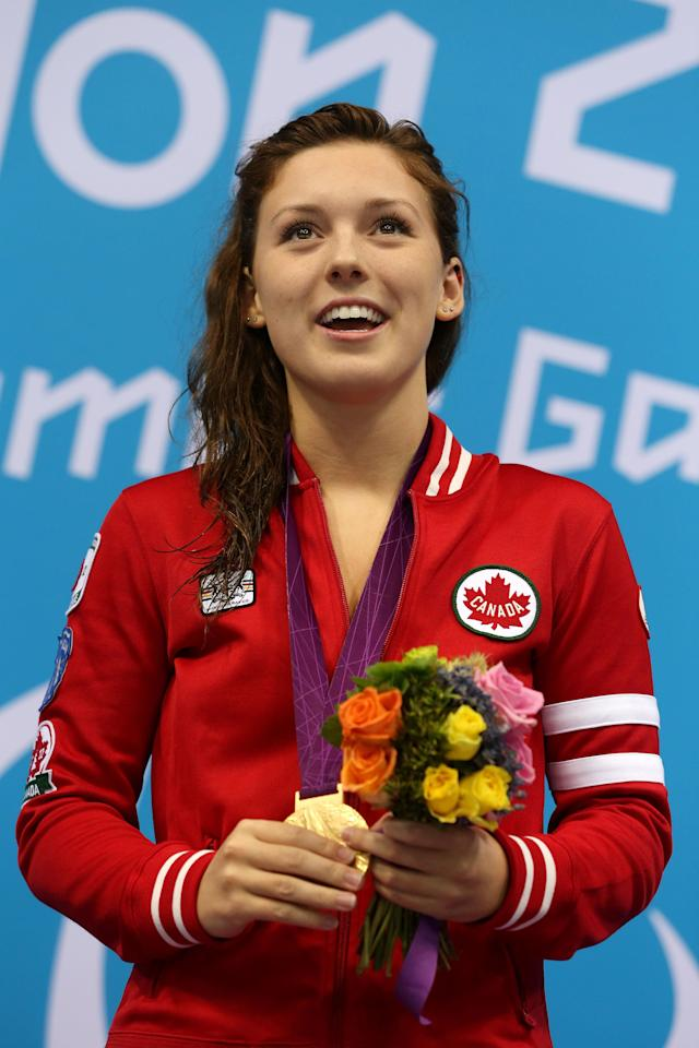 LONDON, ENGLAND - AUGUST 31: Gold medallist Summer Ashley Mortimer of Canada poses on the podium during the medal ceremony for the Women's 50m Freestyle - S10 Final on day 2 of the London 2012 Paralympic Games at Aquatics Centre on August 31, 2012 in London, England. (Photo by Clive Rose/Getty Images)