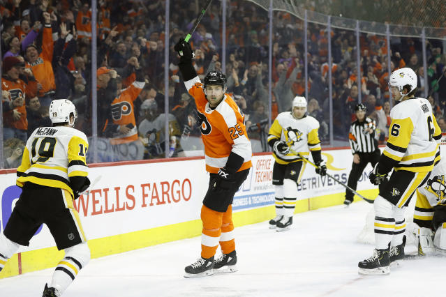 Philadelphia Flyers' James van Riemsdyk (25) celebrates after scoring a goal as Pittsburgh Penguins' Jared McCann (19) and John Marino (6) look on during the second period of an NHL hockey game, Tuesday, Jan. 21, 2020, in Philadelphia. (AP Photo/Matt Slocum)