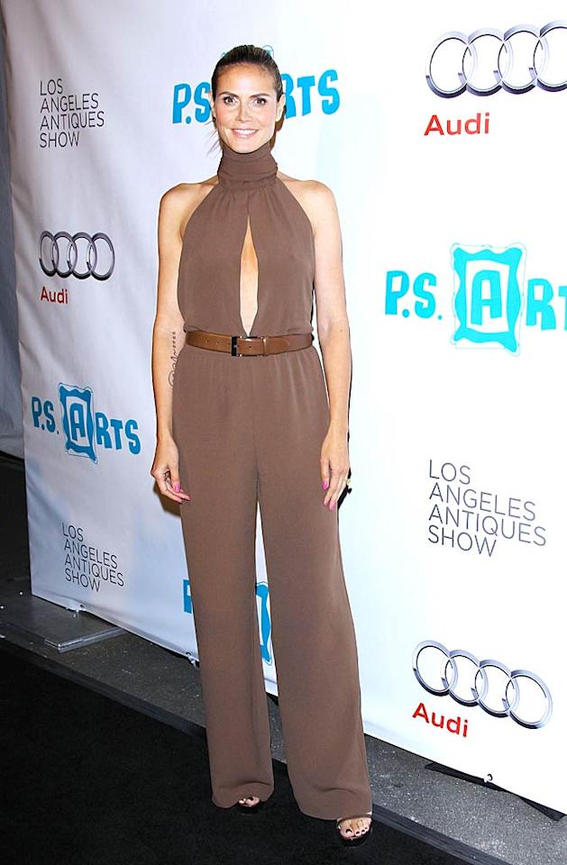 """""""Project Runway"""" hostess Heidi Klum is gorgeous and can get away with wearing just about anything ... except for this. The belted Michael Kors jumpsuit she wore to the 16th annual Los Angeles Antiques Show was baggy, way too long, and appeared to be choking her! Michael Tran/<a href=""""http://www.filmmagic.com/"""" target=""""new"""">FilmMagic.com</a> - April 13, 2011"""