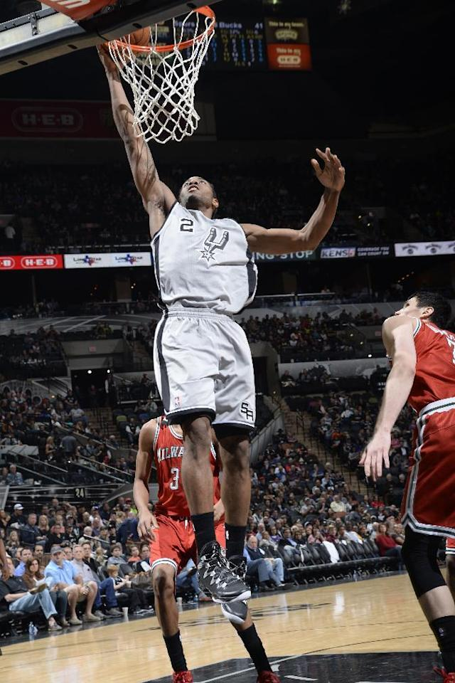 SAN ANTONIO, TX - January 19: Kawhi Leonard #2 of the San Antonio Spurs goes up for the dunk against the Milwaukee Bucks during the game at the AT&T Center on January 19, 2014 in San Antonio, Texas