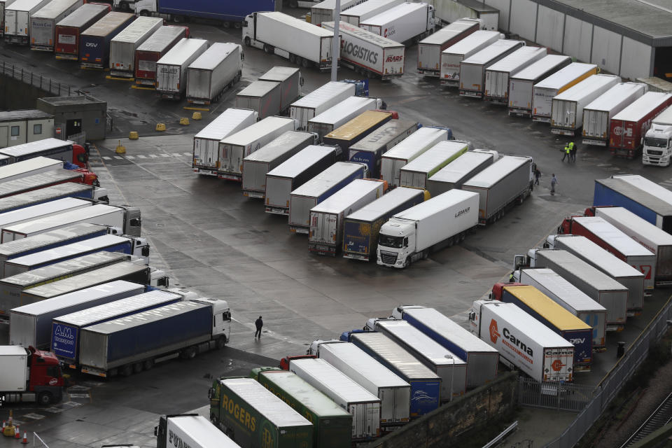 Trucks are parked in Dover, whilst the Port remains closed, in Kent, England, Tuesday, Dec. 22, 2020. Trucks waiting to get out of Britain backed up for miles and people were left stranded at airports as dozens of countries around the world slapped tough travel restrictions on the U.K. because of a new and seemingly more contagious strain of the coronavirus in England. (AP Photo/Kirsty Wigglesworth)