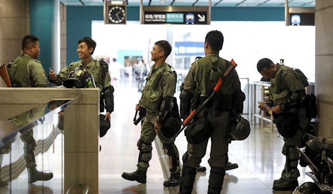 Riot police guard the Airport Express station in Hong Kong. Photo: Dickson Lee
