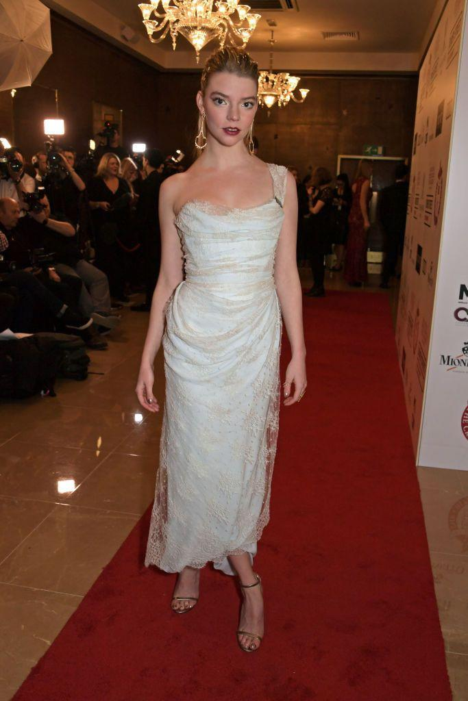 <p>Taylor-Joy wore a draped lace gown for the red carpet event. </p>
