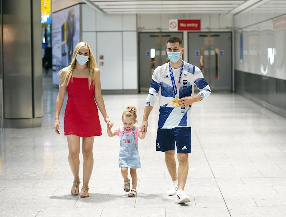 Max Whitlock with his wife Leah and daughter Willow (Steve Parsons/PA) (PA Wire)
