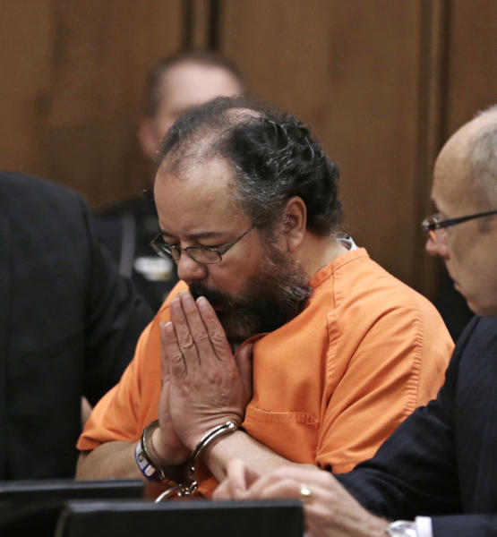 FILE - This Aug. 1, 2013 file photo shows Ariel Castro in the courtroom during the sentencing phase in Cleveland. Castro, who held 3 women captive for a decade, has committed suicide, Tuesday, Sept. 3, 2013. (AP Photo/Tony Dejak, file)