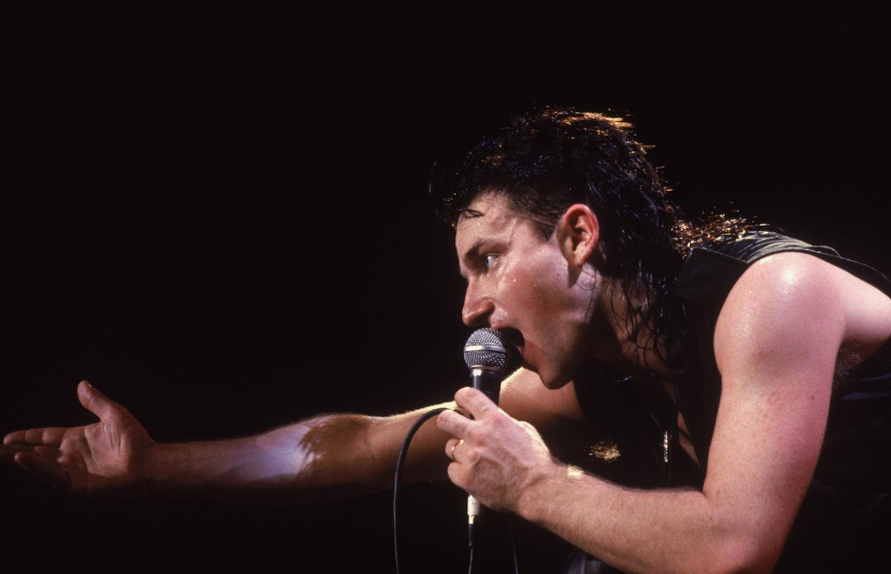 Bono, lead singer of U2, in concert, 1986. (Photo by Dave Hogan/Hulton Archive/Getty Images)