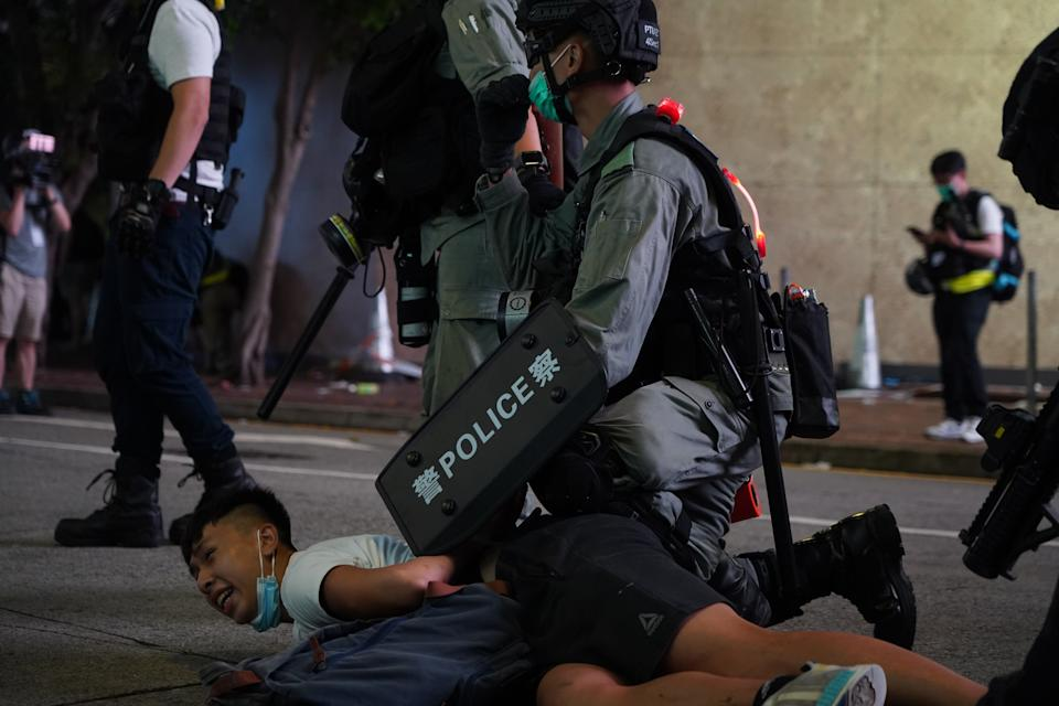Demonstrators are arrested by riot police during a protest in Hong Kong, China, on July 1, 2020. The protest is against new national security law in Hong Kong on the 23rd anniversary of city handover from British to China.  (Photo by Yat Kai Yeung/NurPhoto via Getty Images)