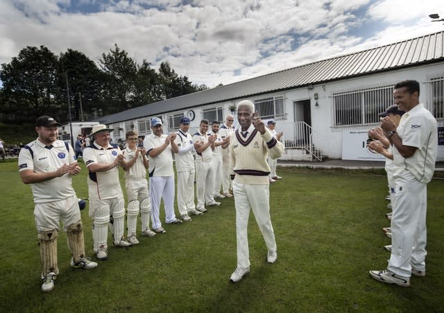 Players form a guard of honour as 85-year-old Cecil Wright walks onto the pitch ahead of playing his last game of competitive cricket at Uppermill Cricket Club in Oldham (Danny Lawson/PA)