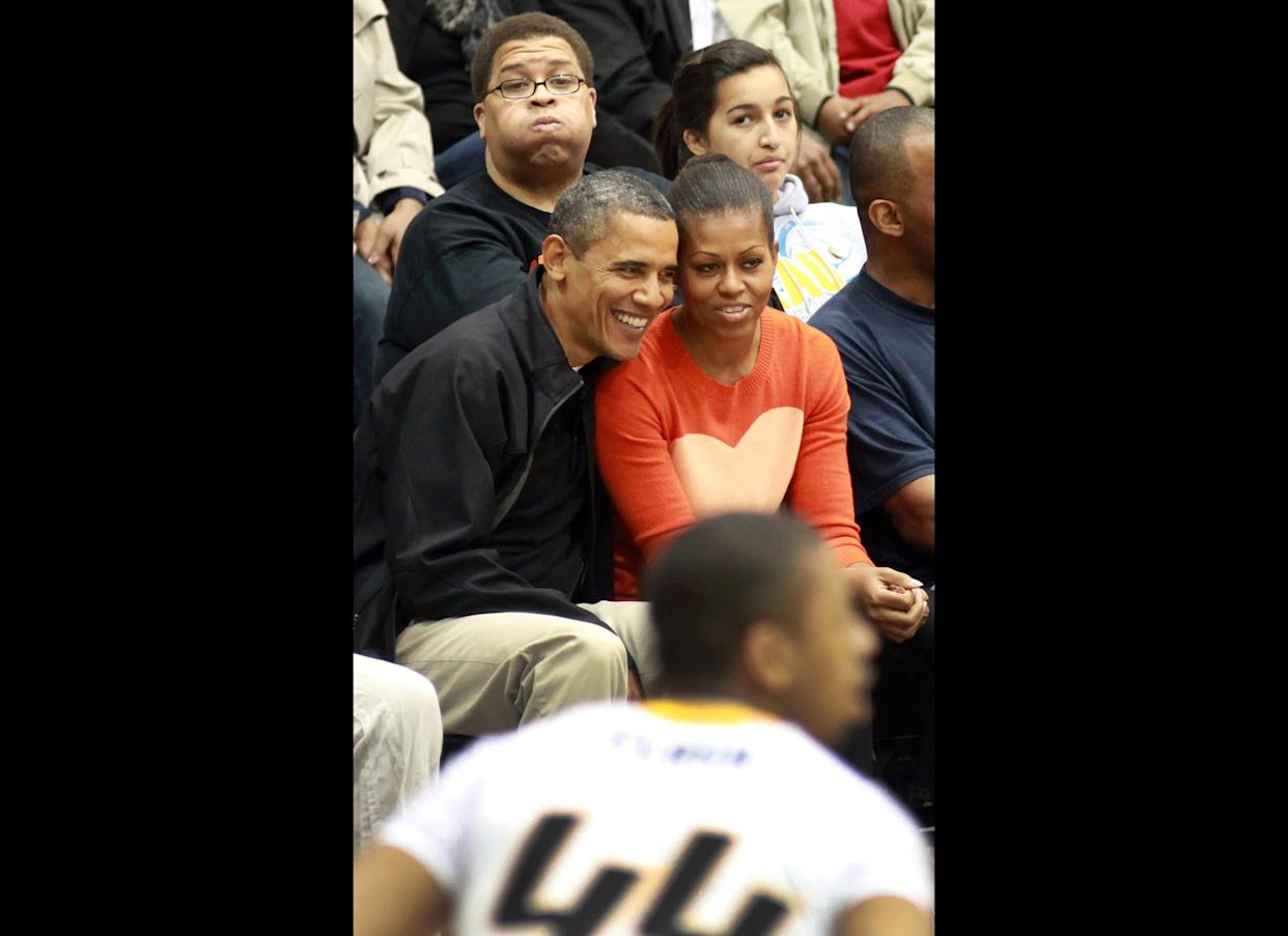 BALTIMORE, MD - NOVEMBER 26: U.S. President Barack Obama and first lady Michelle Obama watch the Oregon State Beavers play the Towson Tigers at the Towson Center on November 26, 2011 in Baltimore, Maryland. The first lady's brother, Craig Robinson, is head coach of the Oregon State team. (Photo by Martin H. Simon-Pool/Getty Images)