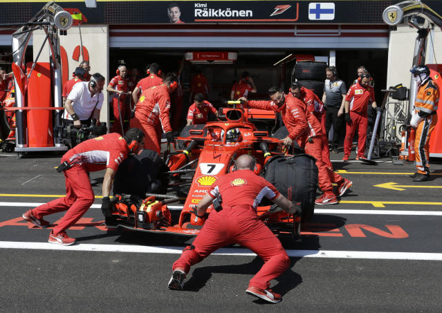 Ferrari driver Kimi Raikkonen of Finland gets a pit service during the second free practice at the Paul Ricard racetrack, in Le Castellet, southern France, Friday, June 22, 2018. The Formula one race will be held on Sunday. (AP Photo/Claude Paris)