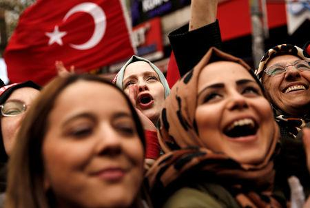Supporters of Turkish President Tayyip Erdogan cheer during a rally for the upcoming local elections in Istanbul, Turkey, March 30, 2019. REUTERS/Murad Sezer