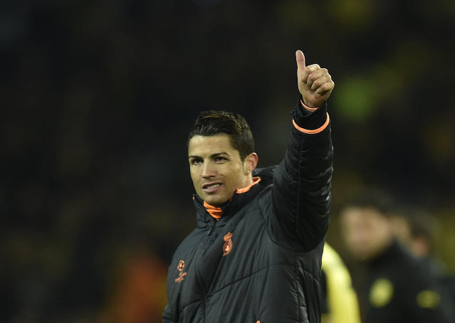 Real's Cristiano Ronaldo waves to his supporters at the end of the the Champions League quarterfinal second leg soccer match between Borussia Dortmund and Real Madrid in the Signal Iduna stadium in Dortmund, Germany, Tuesday, April 8, 2014. (AP Photo/Martin Meissner)