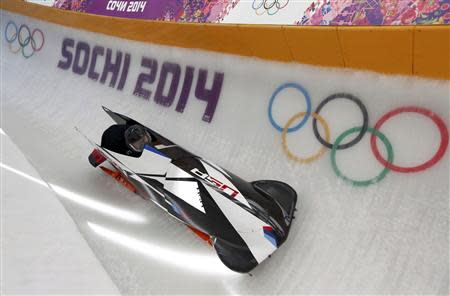 Pilot Steven Holcomb of the U.S. speeds down the track during a two-man bobsleigh training session at the Sochi 2014 Winter Olympics