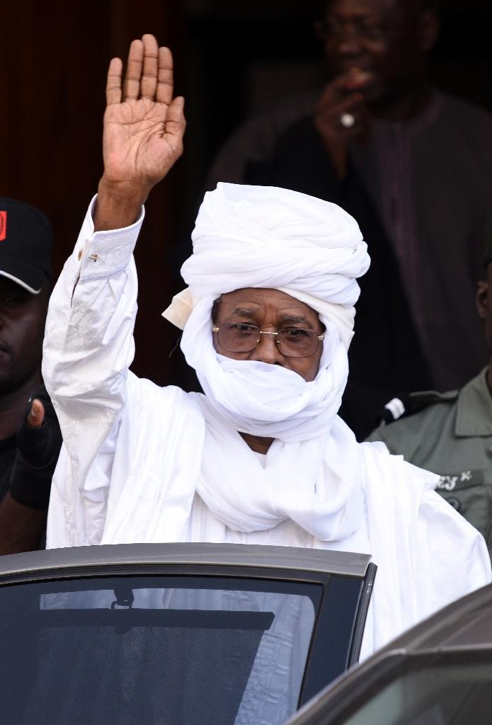 Former Chadian leader Hissene Habre gestures as he leaves a Dakar courthouse after an identity hearing on June 3, 2015 (AFP Photo/Seyllou)