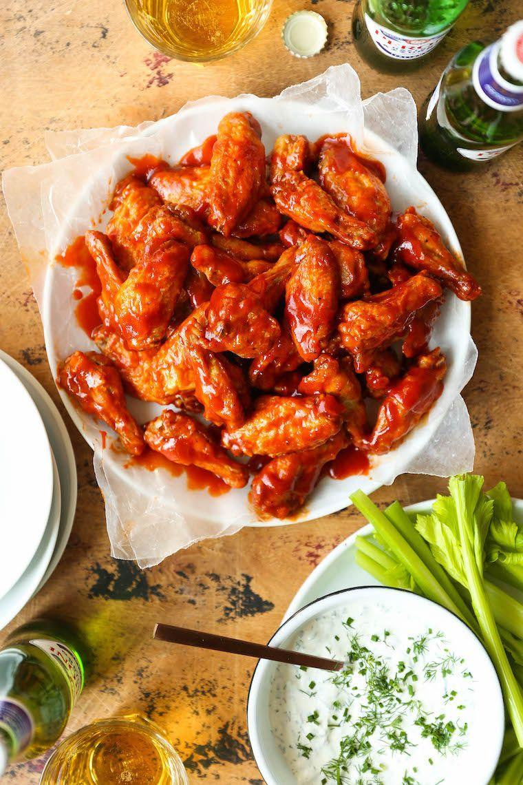 "<p>Impress your party by not only making these sweet and spicy wings from scratch, but by also creating homemade ranch to dip them in.</p><p><strong>Get the recipe at <a href=""https://damndelicious.net/2019/10/21/honey-buffalo-wings-with-homemade-ranch/"" rel=""nofollow noopener"" target=""_blank"" data-ylk=""slk:Damn Delicious"" class=""link rapid-noclick-resp"">Damn Delicious</a>.</strong></p><p><strong><strong><a class=""link rapid-noclick-resp"" href=""https://www.amazon.com/Nordic-Ware-Natural-Aluminum-Commercial/dp/B0049C2S32/?tag=syn-yahoo-20&ascsubtag=%5Bartid%7C10050.g.2966%5Bsrc%7Cyahoo-us"" rel=""nofollow noopener"" target=""_blank"" data-ylk=""slk:SHOP BAKING SHEETS"">SHOP BAKING SHEETS</a></strong><br></strong></p>"