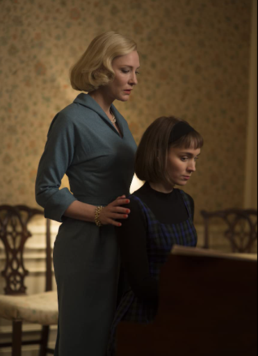 <p>The forbidden love between Carol and Therese is powerful, mostly due to the stellar performances by Cate Blanchett and Rooney Mara. Therese, an aspiring photographer, meets Carol, who is searching for a Christmas present for her daughter. Carol invites Therese to lunch after she returns her misplaced gloves, and then invites her to her home. Carol surprises Therese and invites her on a trip to escape her looming divorce. The two kiss and begin having an affair. While navigating through Carol's divorce, her feelings for Therese are used as leverage against her in custody discussions. To avoid a public scandal, Carol gives up custody of her daughter. Carol tells Therese that she loves her, and asks Therese to meet her for dinner. Therese obliges and the two gaze into each other's eyes. </p>