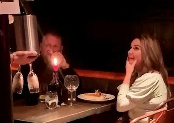 A prankster stitched up a pal on a first date - by ordering a dessert to his table with a plate decorated to read 'Will you marry me?'. Lee McIver, 24, knew his friend Stephen Durand, 38, was meeting a woman at a steak restaurant for a romantic meal. But he called the restaurant, Finsbay Flatiron, in Glasgow, pretending to be Stephen, who works as a roofer, and told staff he was planning to pop the question to his date. Restaurant workers brought out prosecco and a cheesecake on a plate decorated with 'will you marry me' - as a friend of Lee's filmed it from another table. The baffled woman told waiting staff 'this isn't ours, 100 per cent it's not hours' as the cake was presented at the table.